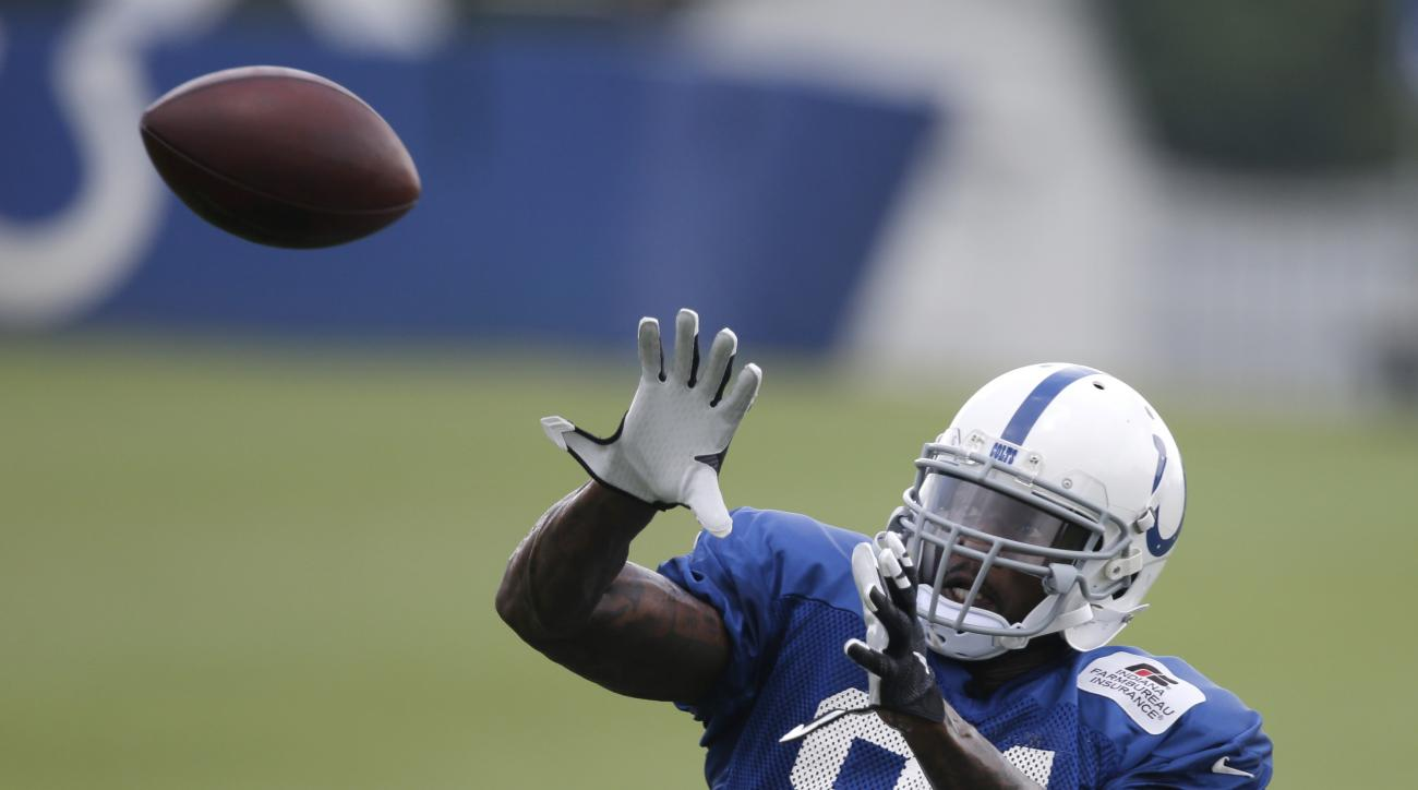Indianapolis Colts' Andre Johnson makes a catch during NFL football training camp Monday, Aug. 10, 2015, in Anderson, Ind. (AP Photo/Darron Cummings)