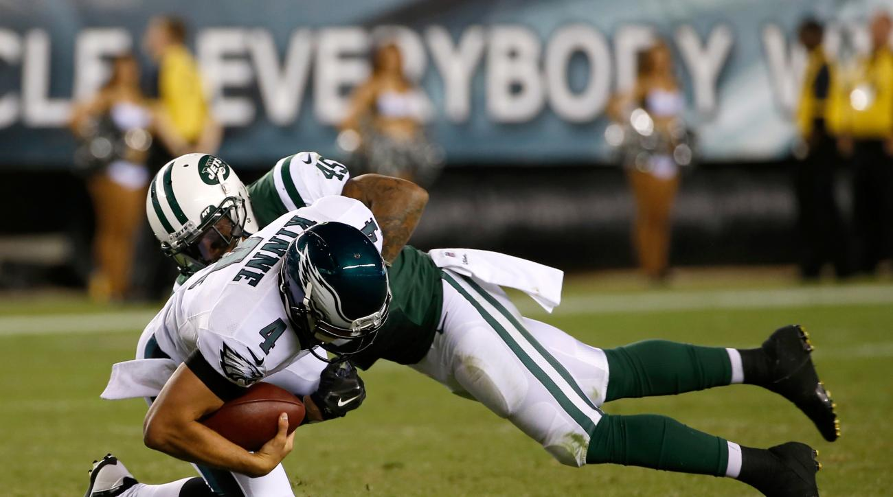 File-This Aug. 28, 2014, file photo shows Philadelphia Eagles' G.J. Kinne, left, being hit by New York Jets' Rontez Miles during the second half of an NFL preseason football game in Philadelphia. It was last December 18, and Miles found out he would be on