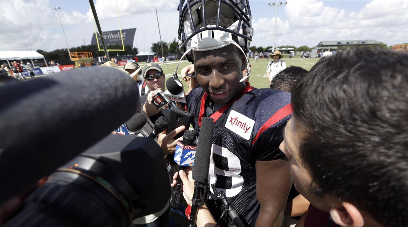 FILE - In this Aug. 5, 2015, file photo, Houston Texans running back Alfred Blue talks with the media after an NFL football training camp practice in Houston. Alfred Blue had a solid rookie season in 2014 backing up Arian Foster. Now that Foster is out in