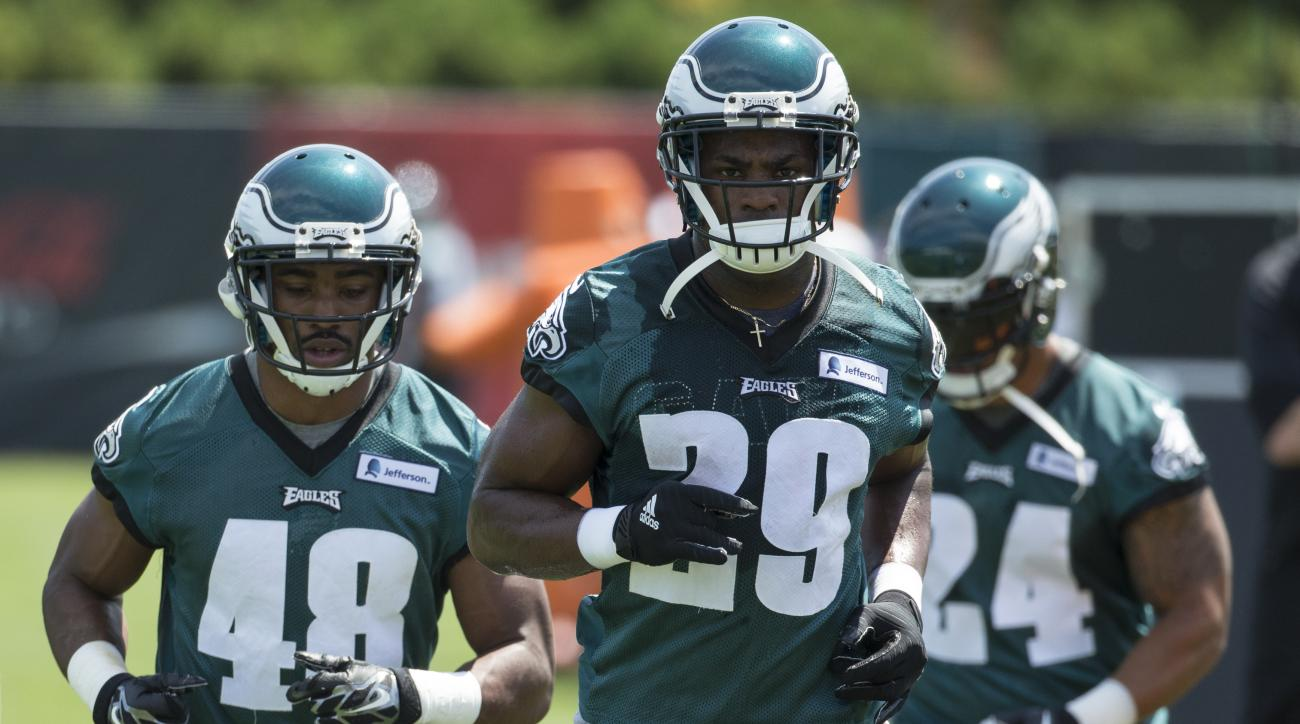 FILE - In this Aug. 2, 2015, file photo, Philadelphia Eagles running back DeMarco Murray (29) heads over to the next drill as Raheem Mostert, left, and Ryan Mathews follow during practice at NFL football training camp in Philadelphia. DeMarco Murray trade