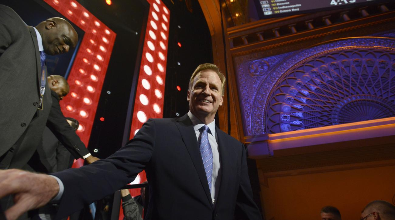 NFL commissioner Roger Goodell walks around the Auditorium Theater to meet fans during in the third round of the 2015 NFL Football Draft,  Friday, May 1, 2015, in Chicago. (AP Photo/Paul Beaty)