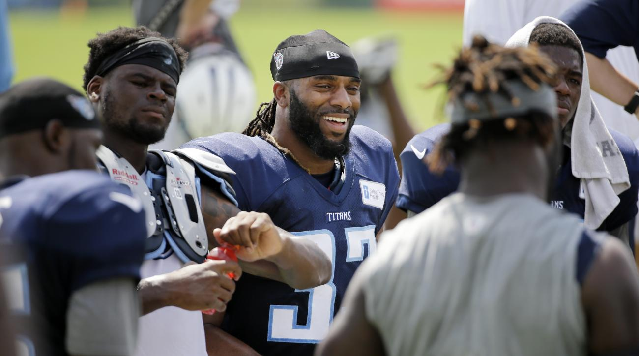 """Tennessee Titans safety Michael Griffin, center, talks with teammates after a practice at NFL football training camp, Tuesday, Aug. 11, 2015, in Nashville, Tenn. Griffin, 30, known as """"Old Man Griff""""or """"Grandpa"""" by his teammates, is heading into his ninth"""