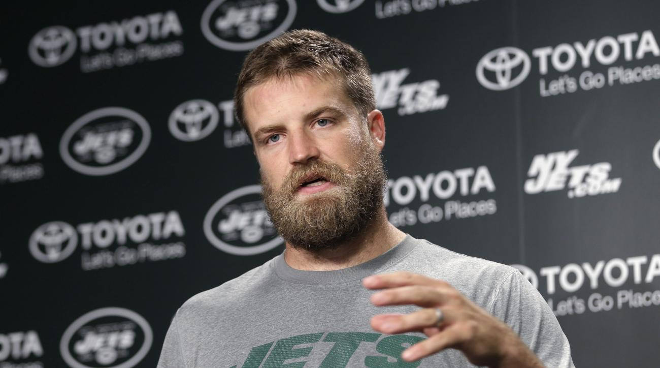 New York Jets quarterback Ryan Fitzpatrick speaks to reporters after NFL football practice in Florham Park, N.J., Tuesday, Aug. 11, 2015. Quarterback Geno Smith will be sidelined at least 6-10 weeks with a broken jaw after being punched by teammate Ikemef