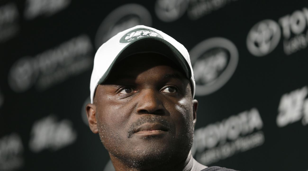 New York Jets coach Todd Bowles speaks to reporters after NFL football practice in Florham Park, N.J., Tuesday, Aug. 11, 2015. Quarterback Geno Smith will be sidelined at least 6-10 weeks with a broken jaw after being punched by teammate Ikemefuna Enemkpa