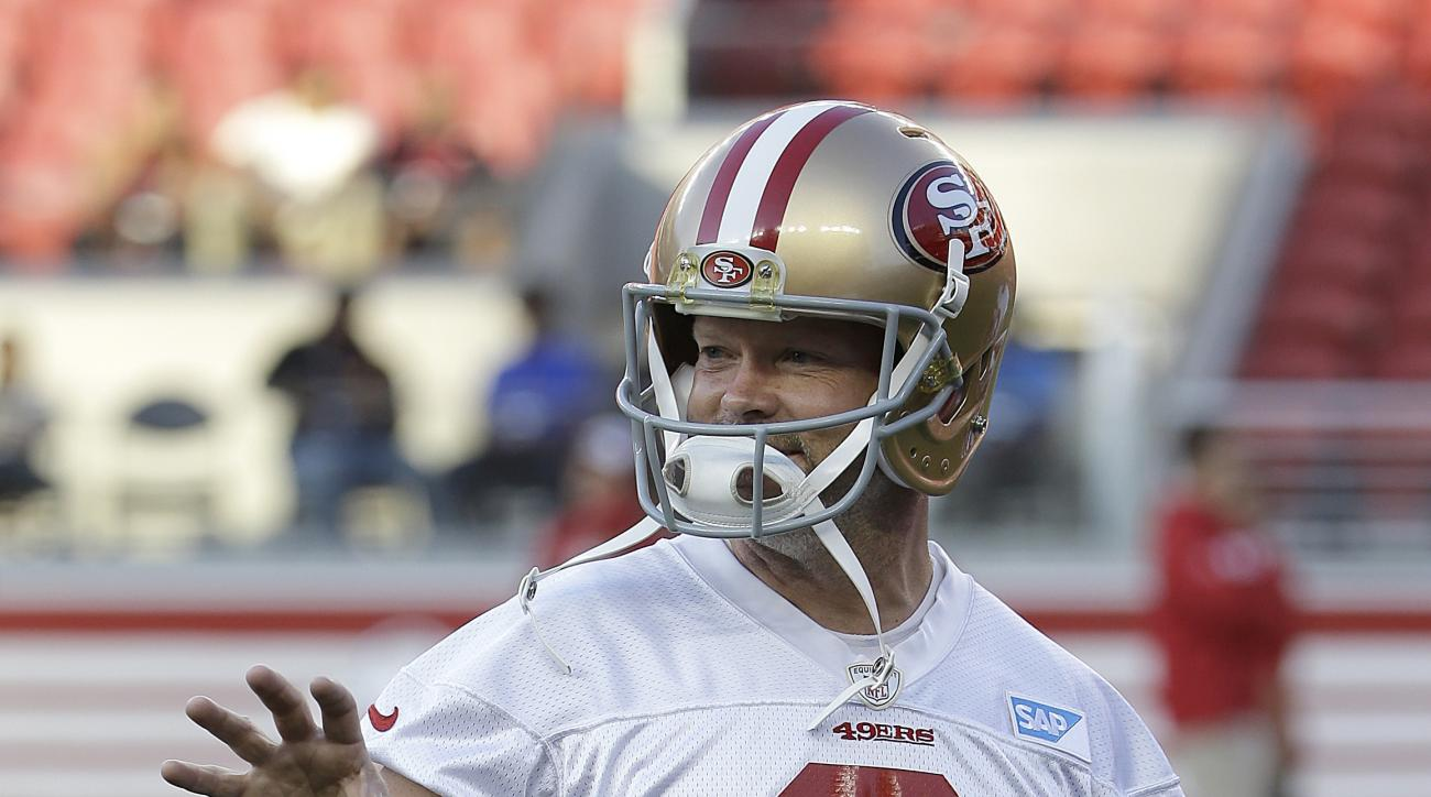 FILE - In this Saturday, Aug. 1, 2015, photo, San Francisco 49ers kicker Phil Dawson gestures during the team's NFL football training camp in Santa Clara, Calif. Phil Dawson is thoroughly enjoying his role as mentor for strong-legged punter Bradley Pinion