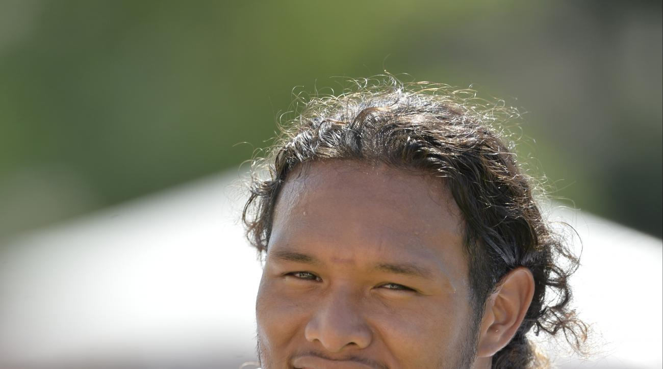 FILE - In this Aug. 4, 2015, file photo, Cleveland Browns defensive tackle Danny Shelton walks off the field after practice at NFL football training camp in Berea, Ohio. At 339 pounds and with frizzy hair flowing from his helmet, Browns rookie defensive t