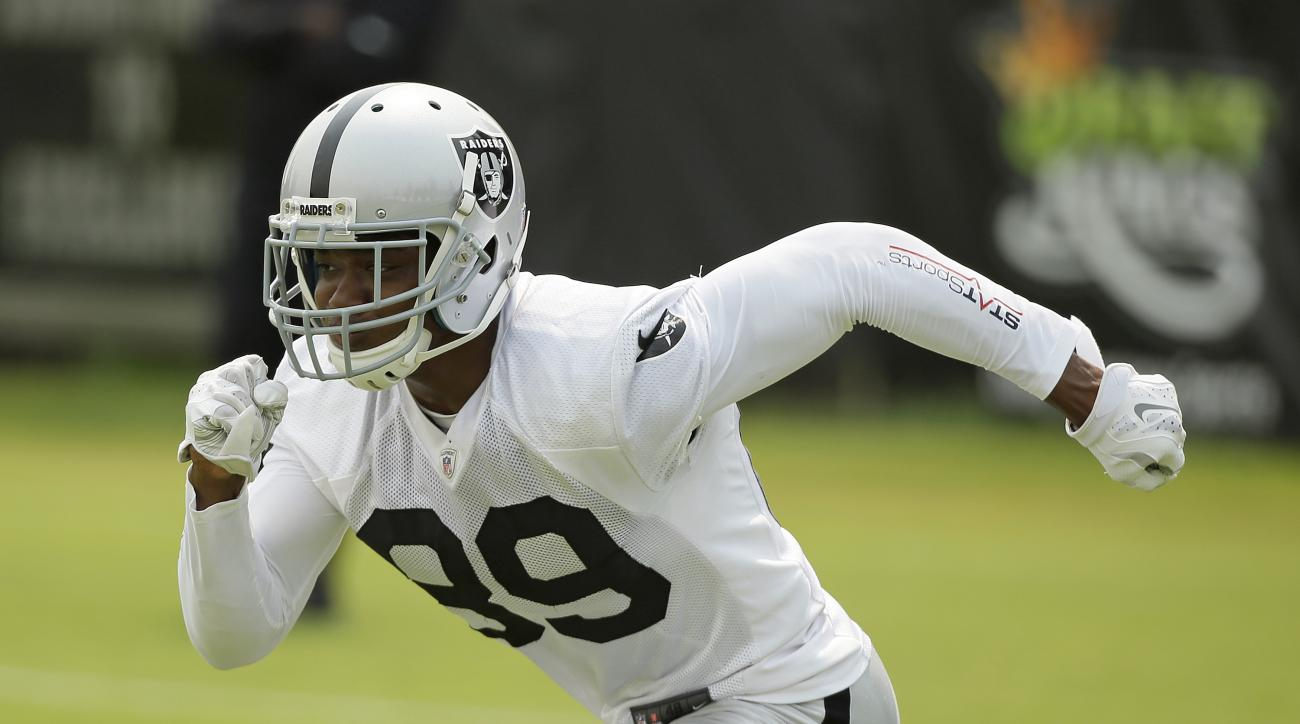 FILE - In this July 31, 2015, file photo, Oakland Raiders wide receiver Amari Cooper goes out for a pass during their football training camp in Napa, Calif. Raiders quarterback Derek Carr is excited to show off his shiny new toy when rookie receiver Amari