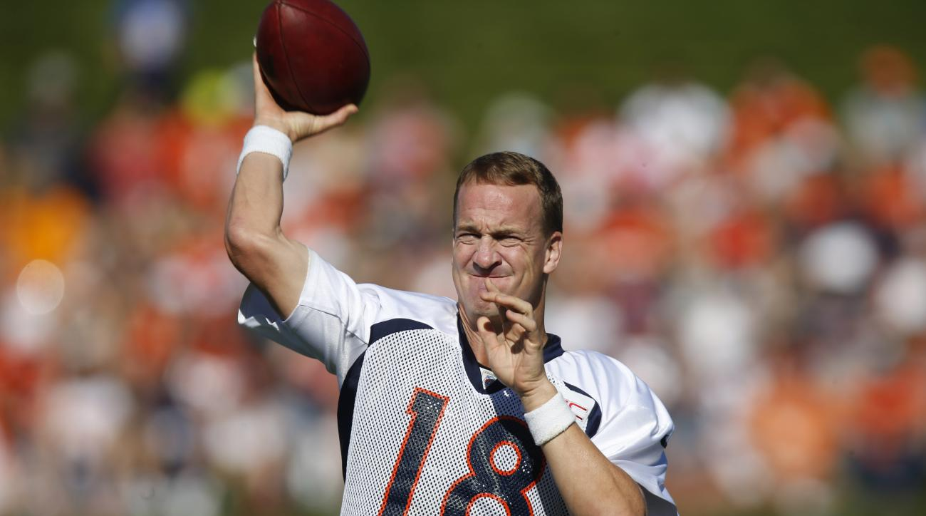 Denver Broncos quarterback Peyton Manning throws during the morning session at the team's NFL football training camp Wednesday, Aug. 12, 2015, in Englewood, Colo. (AP Photo/David Zalubowski)