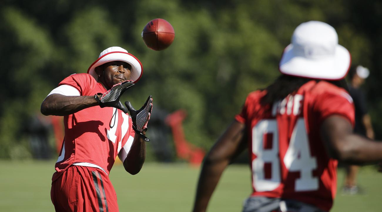 Atlanta Falcons' Julio Jones, left, catches a pass from teammate Roddy White during NFL football training camp Wednesday, Aug. 12, 2015, in Flowery Branch, Ga. (AP Photo/David Goldman)