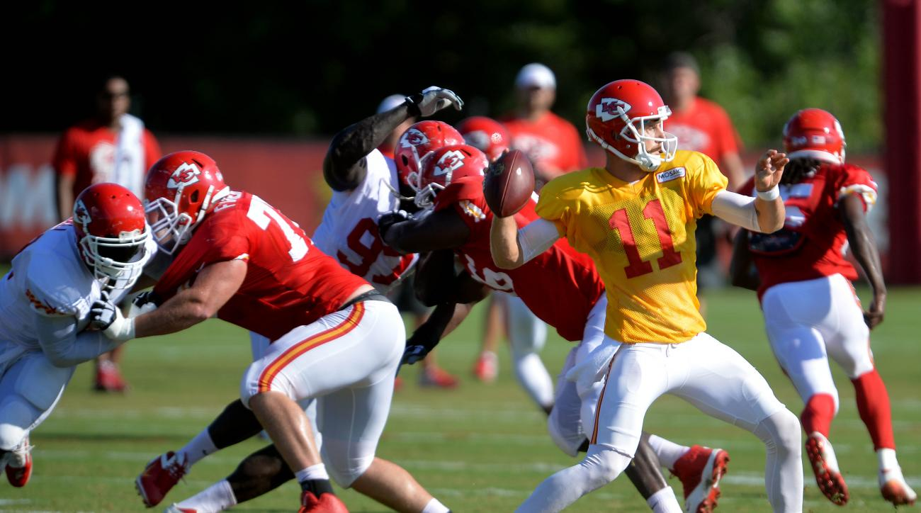 Kansas City Chiefs quarterback Alex Smith throws a pass during an NFL football training camp practice Wednesday, Aug. 12, 2015, in St. Joseph, Mo. (Andrew Carpenean/The St. Joseph News-Press via AP)