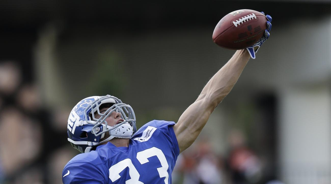 New York Giants safety Justin Halley makes a catch during a joint NFL football training camp with the Cincinnati Bengals, Wednesday, Aug. 12, 2015, in Cincinnati. (AP Photo/John Minchillo)