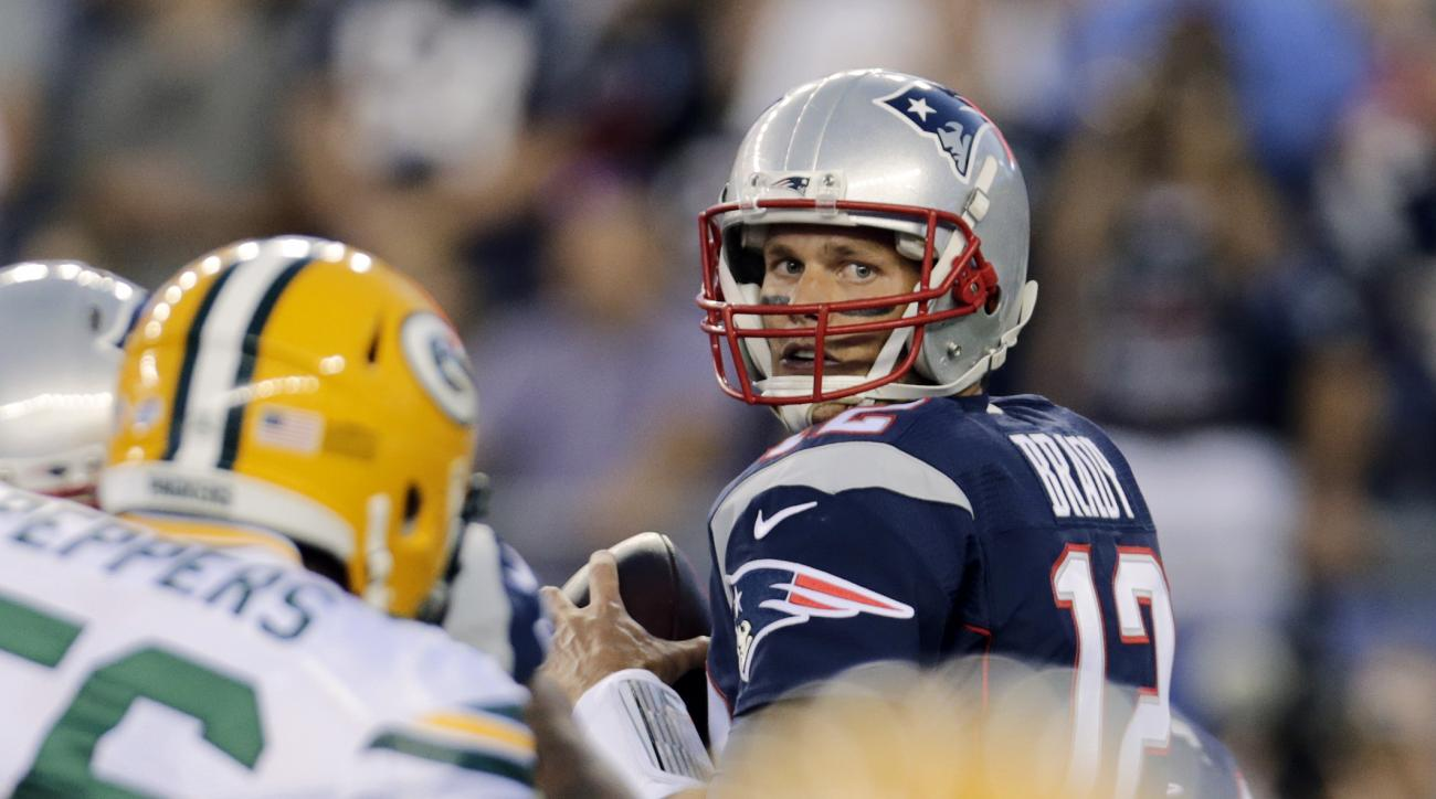 New England Patriots quarterback Tom Brady looks for a receiver during the first half of an NFL preseason football game against the Green Bay Packers, Thursday, Aug. 13, 2015, in Foxborough, Mass. (AP Photo/Charles Krupa)