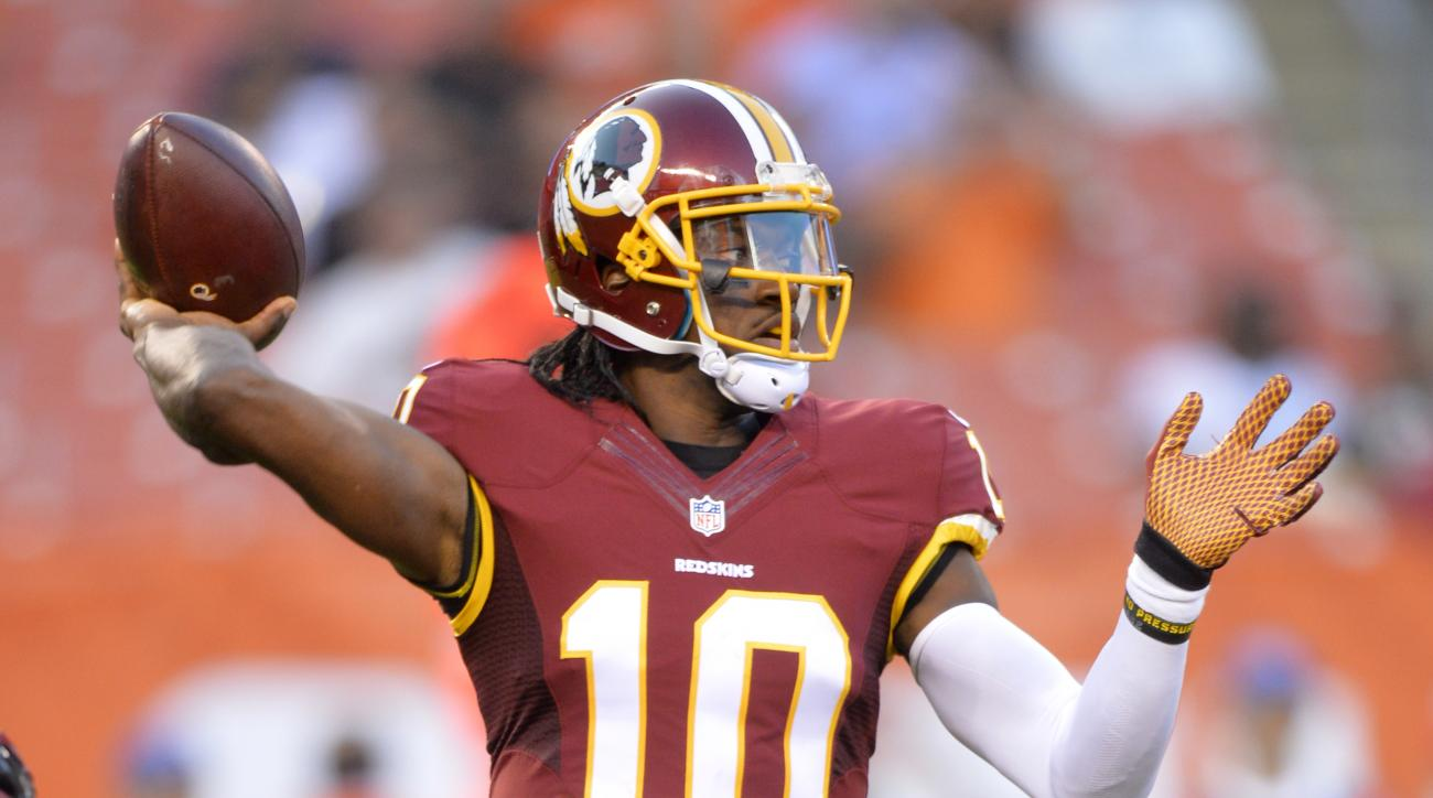 Washington Redskins quarterback Robert Griffin III throws against the Cleveland Browns during the first quarter of an NFL preseason football game, Thursday, Aug. 13, 2015, in Cleveland. (AP Photo/David Richard)