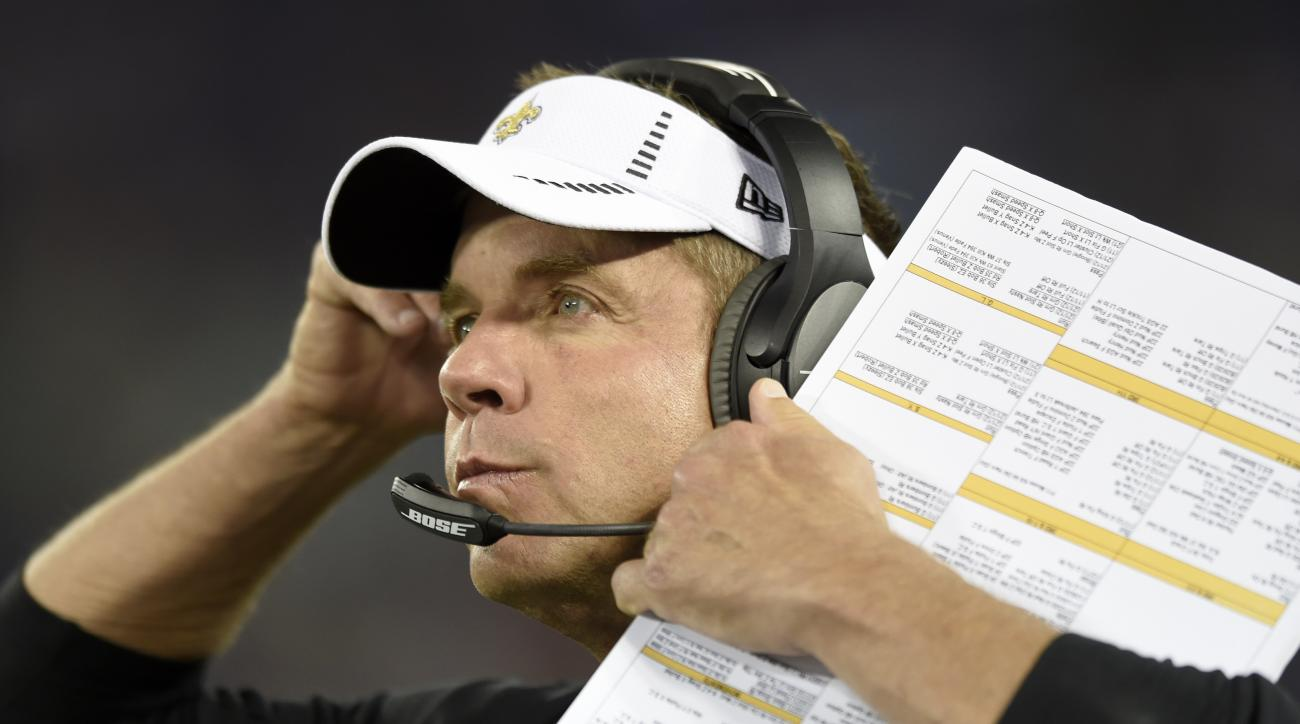New Orleans Saints head coach Sean Payton watches the action from the sidelines during the first half of an NFL preseason football game against the Baltimore Ravens in Baltimore, Thursday, Aug. 13, 2015. (AP Photo/Gail Burton)