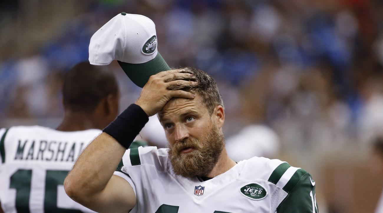 New York Jets quarterback Ryan Fitzpatrick wipes his forehead during the second half of an NFL preseason football game against the Detroit Lions, Thursday, Aug. 13, 2015, in Detroit. (AP Photo/Paul Sancya)
