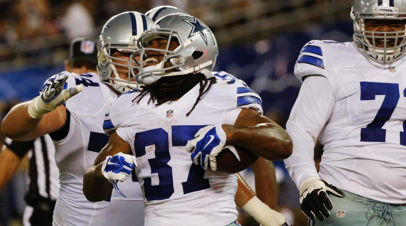 Dallas Cowboys running back Gus Johnson (37) celebrates his touchdown against the San Diego Chargers during the first half of an NFL preseason football game Thursday, Aug. 13, 2015 in San Diego. (AP Photo/Lenny Ignelzi)