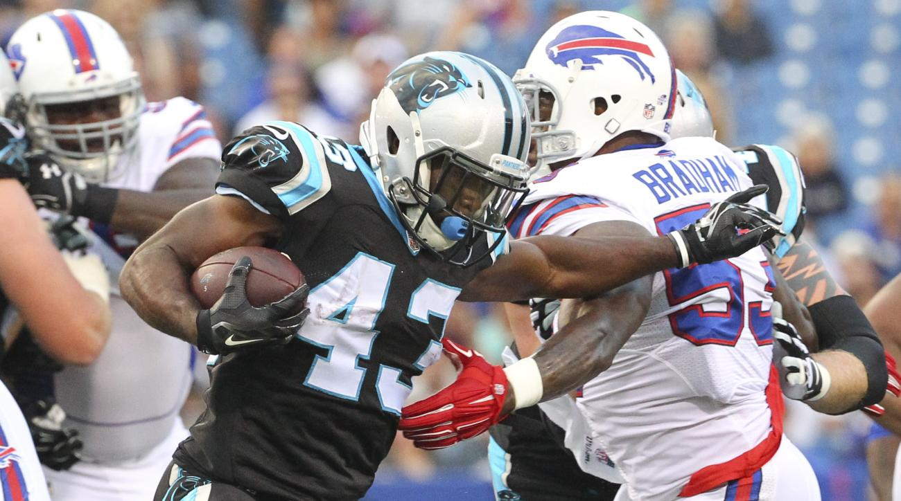 Carolina Panthers running back Fozzy Whittaker (43) runs against Buffalo Bills outside linebacker Nigel Bradham (53) during the first half of an NFL preseason football game on Friday, Aug. 14, 2015, in Orchard Park, N.Y. (AP Photo/Bill Wippert)
