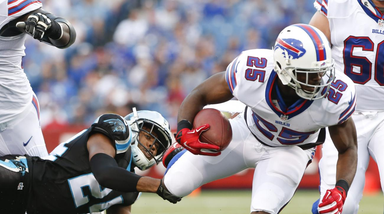 Buffalo Bills running back LeSean McCoy (25) is tripped up by Carolina Panthers cornerback Josh Norman (24) during the first half of an NFL preseason football game on Friday, Aug. 14, 2015, in Orchard Park, N.Y. (AP Photo/Heather Ainsworth)