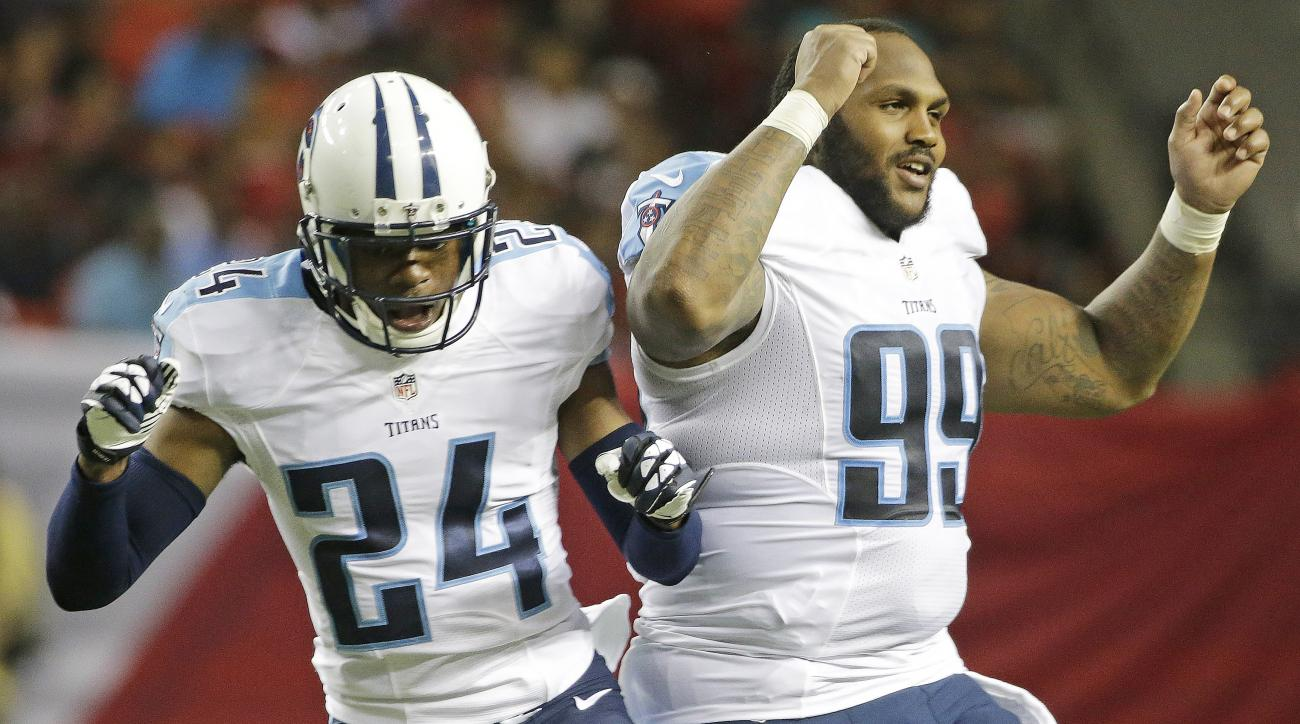 Tennessee Titans cornerback Coty Sensabaugh (24) and Tennessee Titans defensive end Jurrell Casey (99) celebrate a Tennessee Titans touchdown against the Atlanta Falcons during the first half of an NFL football preseason game , Friday, Aug. 14, 2015, in A