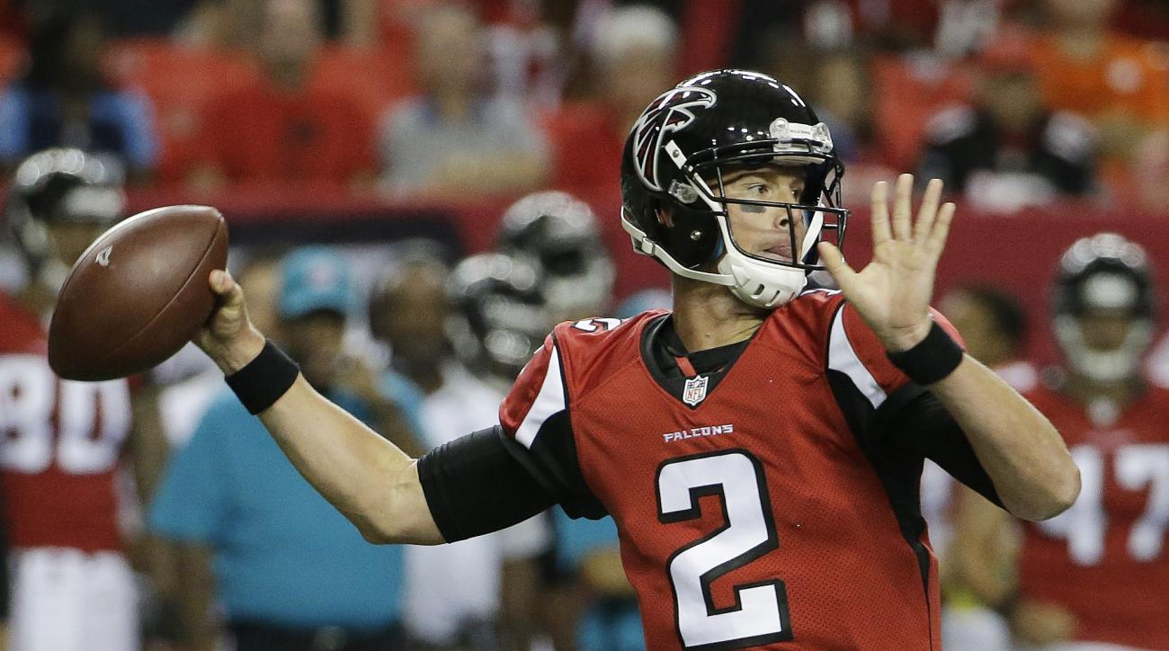 Atlanta Falcons quarterback Matt Ryan (2) works against the Tennessee Titans during the first half of an NFL football preseason game , Friday, Aug. 14, 2015, in Atlanta. (AP Photo/David Goldman)