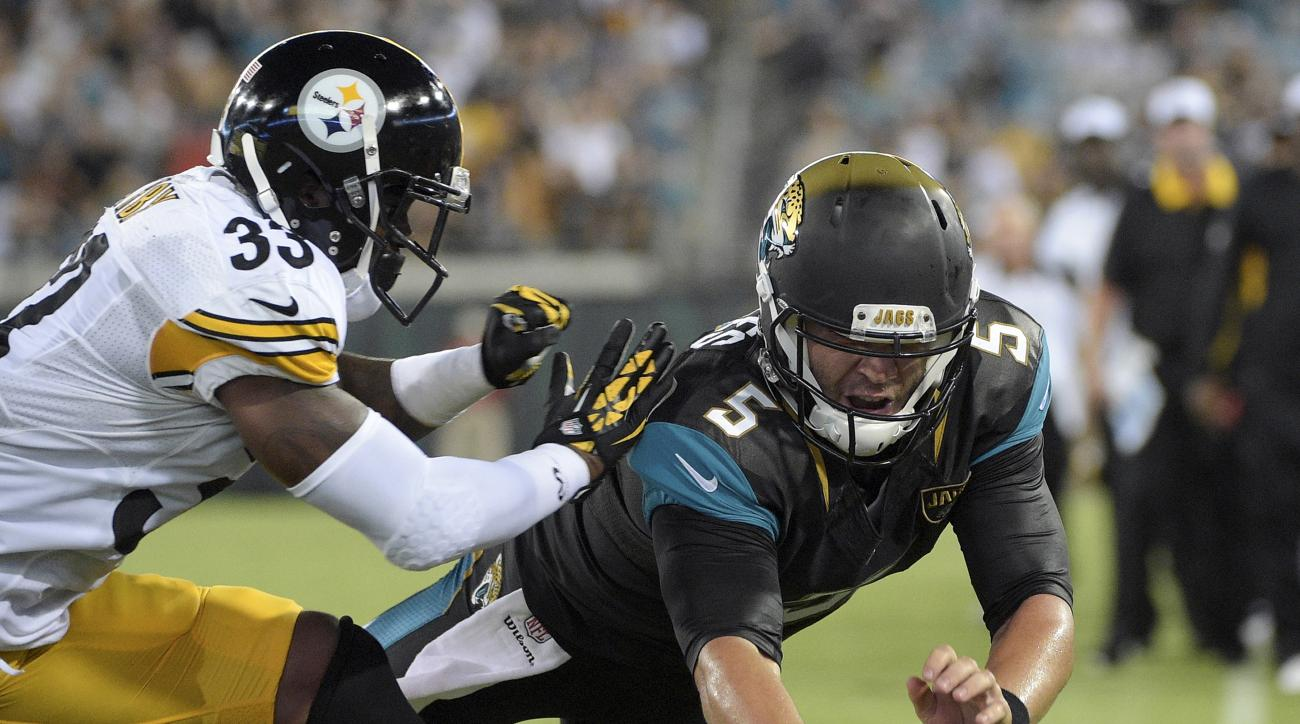 Jacksonville Jaguars quarterback Blake Bortles dives over the goal for a 4-yard touchdown past Pittsburgh Steelers defensive back Alden Darby (33) during the first half of an NFL preseason football game, Friday, Aug. 14, 2015, in Jacksonville, Fla. (AP Ph