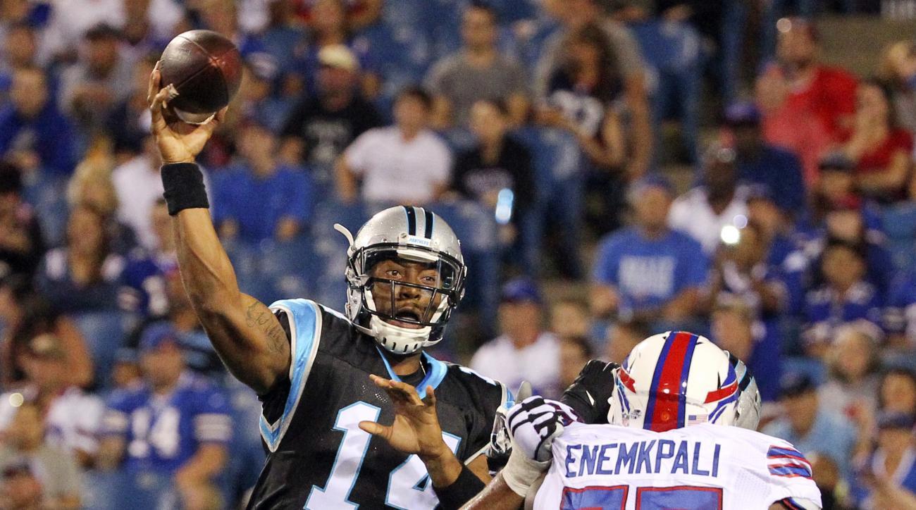 Carolina Panthers quarterback Joe Webb (14) passes under pressure from Buffalo Bills linebacker Ikemefuna Enemkpali (75) during the second half of an NFL preseason football game on Friday, Aug. 14, 2015, in Orchard Park, N.Y. (AP Photo/Bill Wippert)