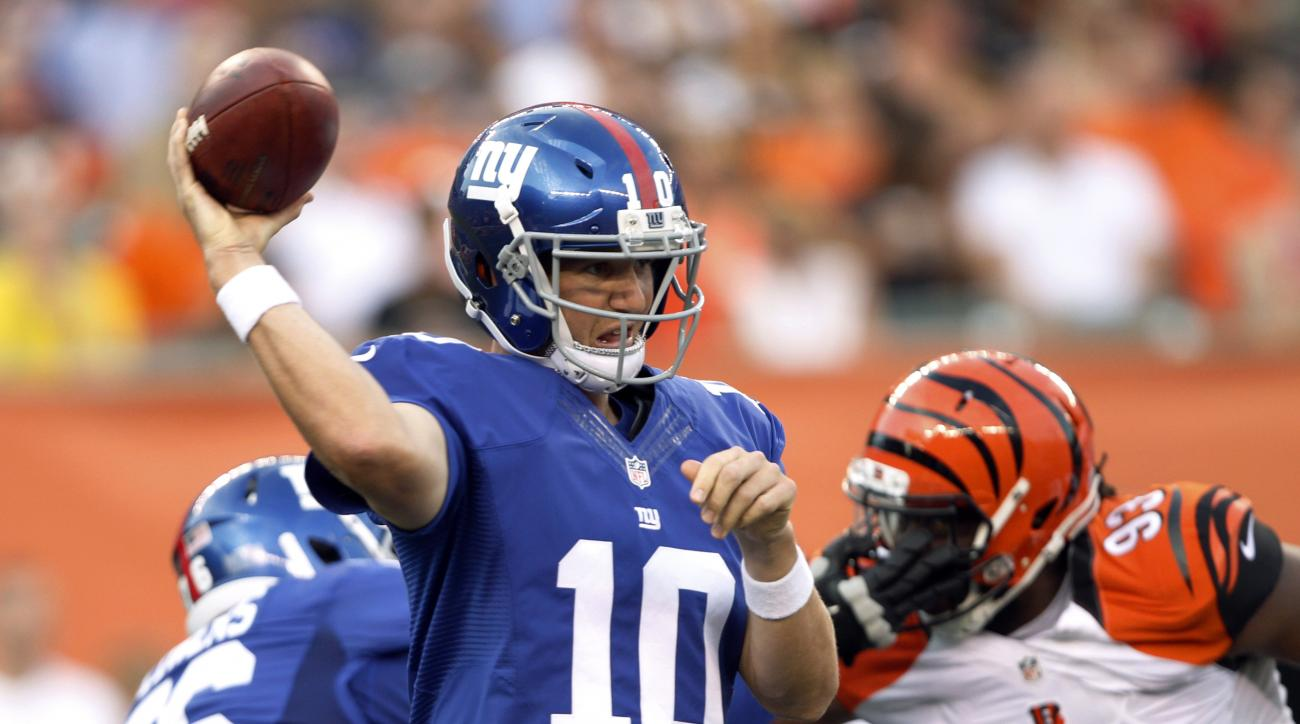 New York Giants quarterback Eli Manning (10) throws against the Cincinnati Bengals during the first half of an NFL preseason football game in Cincinnati, Friday, Aug. 14, 2015. (AP Photo/Frank Victores)