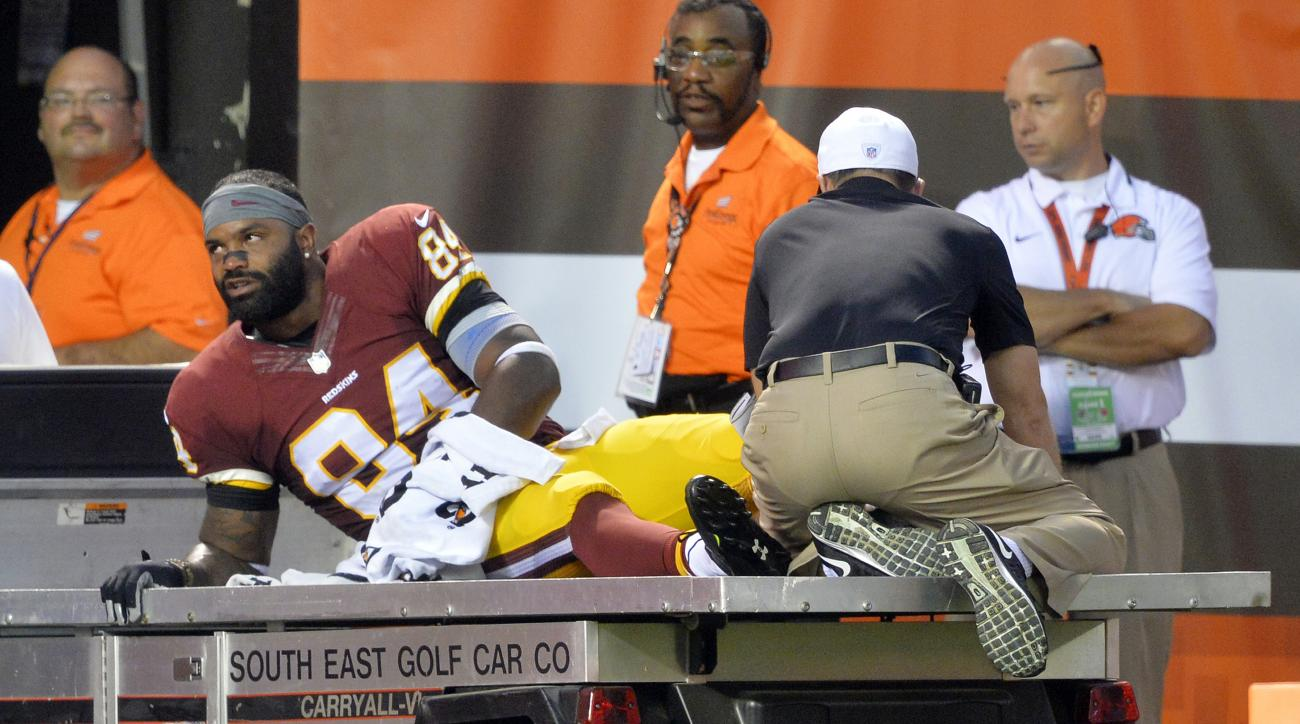 In this Aug. 13, 2015, photo, Washington Redskins tight end Niles Paul leaves on a cart during the first quarter after an injury during an NFL preseason football game against the Cleveland Browns in Cleveland.  At this point, Jordan Reed, whose biggest fl