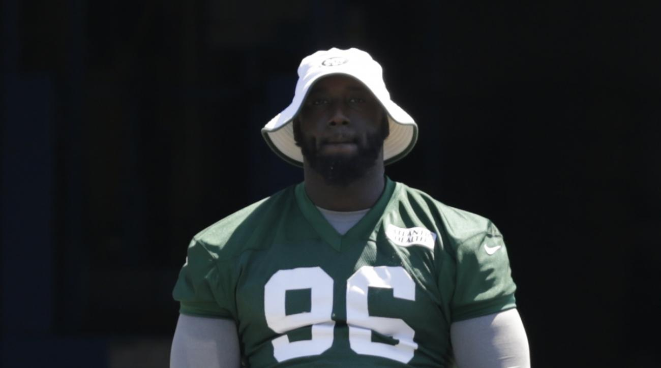 New York Jets' Muhammad Wilkerson (96) rides a stationary bike during practice at NFL football training camp, Tuesday, Aug. 4, 2015, in Florham Park, N.J. (AP Photo/Frank Franklin II)