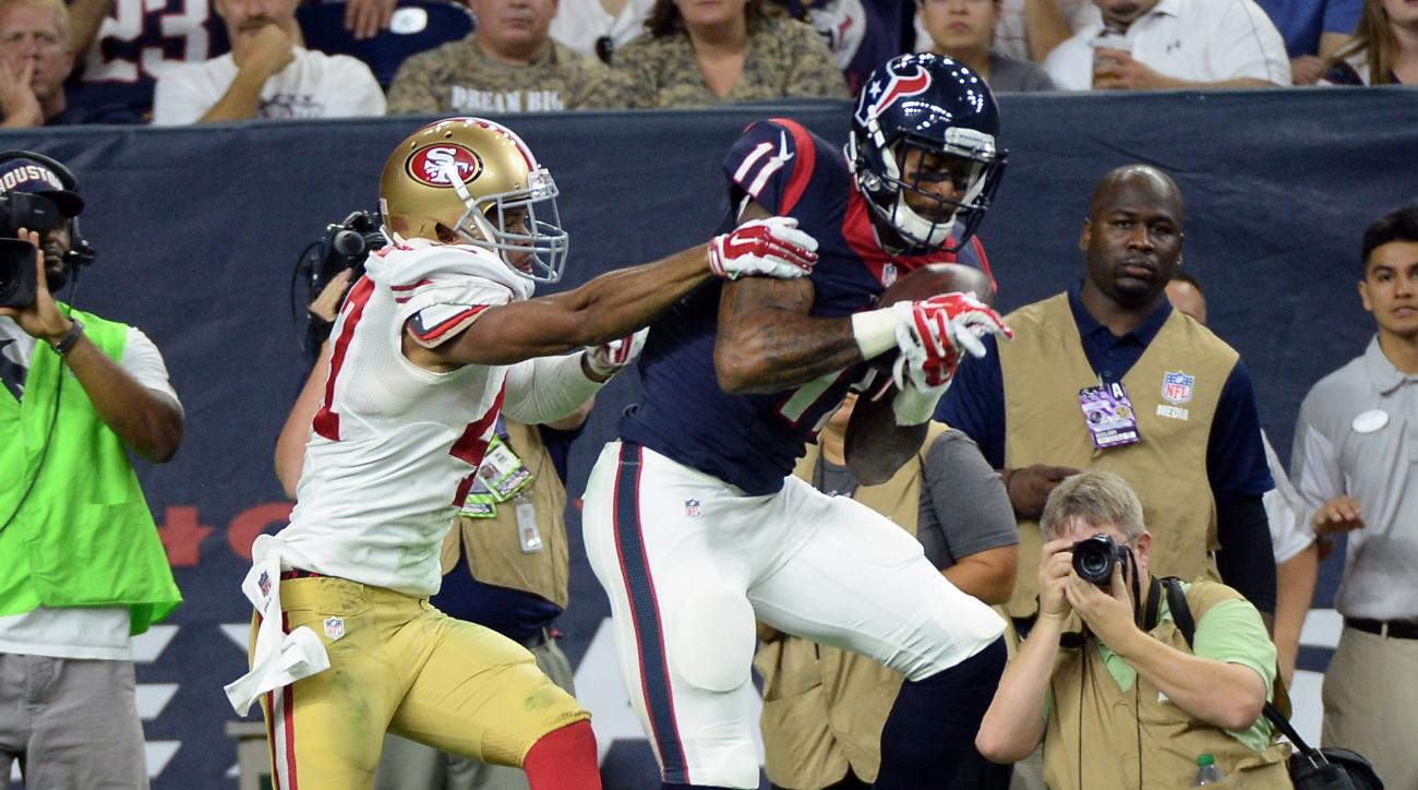Houston Texans' Jaelen Strong (11) catches a pass for a touchdown as San Francisco 49ers' Marcus Cromartie (47) defends him during the second half of an NFL preseason football game, Saturday, Aug. 15, 2015, in Houston. (AP Photo/George Bridges)