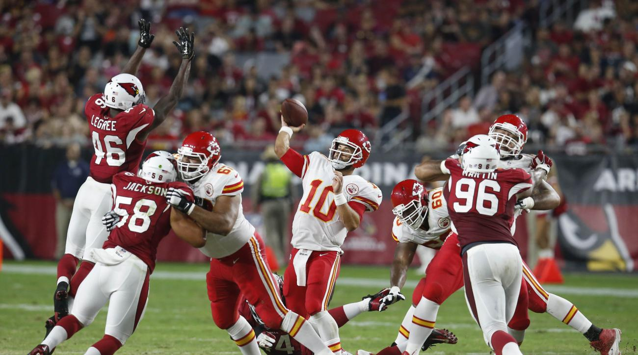 Kansas City Chiefs quarterback Chase Daniel (10) throws under pressure from the Arizona Cardinals during the second half of an NFL preseason football game, Saturday, Aug. 15, 2015, in Glendale, Ariz. (AP Photo/Rick Scuteri)