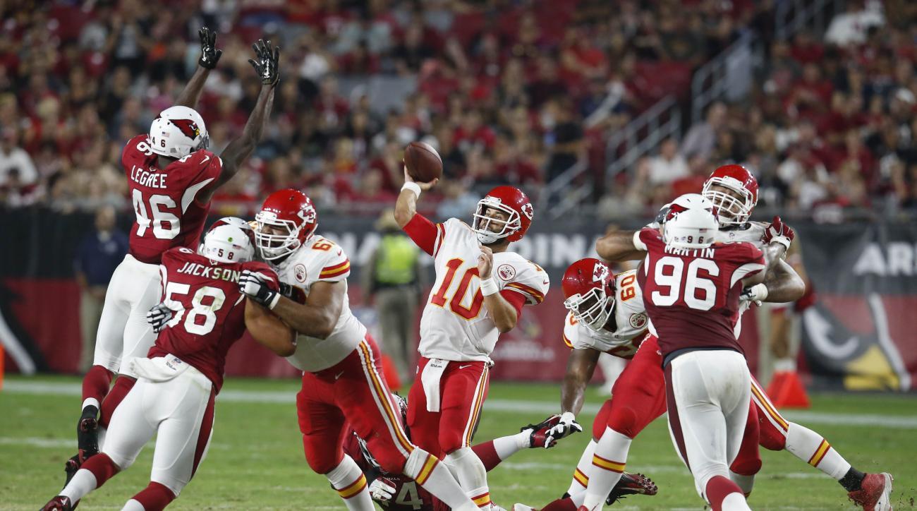 Kansas City Chiefs quarterback Chase Daniel (10) throws under pressure from the Arizona Cardinals during the second half of an NFL preseason football game, Saturday, Aug. 15, 2015, in Glendale, Ariz. (AP Photo/Rick Scuteri)