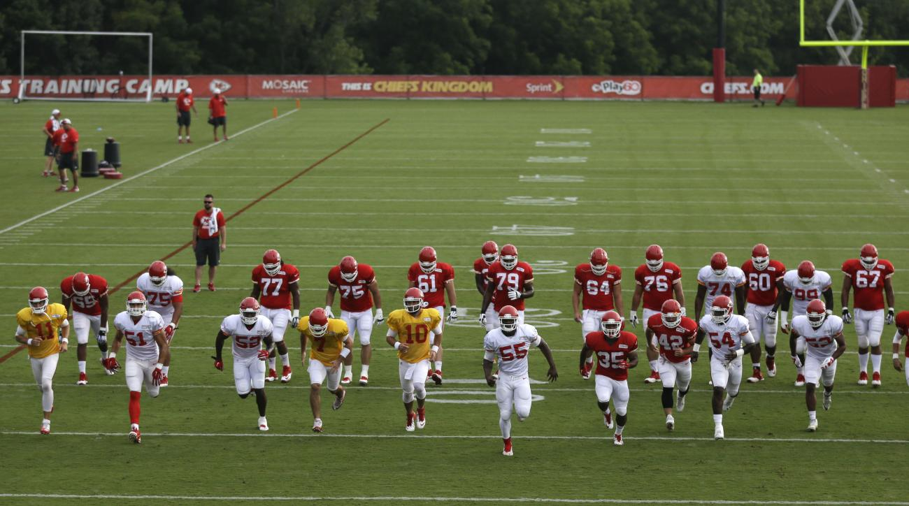 Kansas City Chiefs players warm up for practice during NFL football training camp in St. Joseph, Mo., Monday, Aug. 17, 2015. (AP Photo/Orlin Wagner)