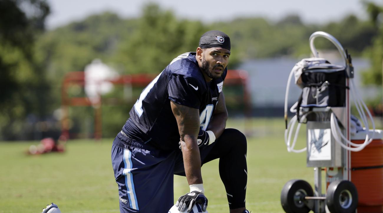 In this July 31, 2015 photo, Tennessee Titans linebacker Derrick Morgan takes a break during NFL football training camp in Nashville, Tenn. Morgan looked at other teams this offseason before the Titans convinced him to sign a new deal. Now he's paired opp