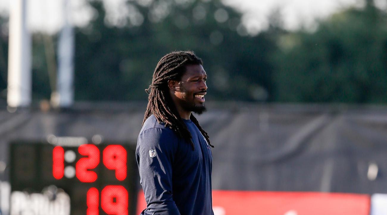 Houston Texans linebacker Jadeveon Clowney (90) looks on during an NFL football training camp at the Methodist Training Center on Saturday August 1, 2015 in Houston, Texas. (AP Photo/Bob Levey)