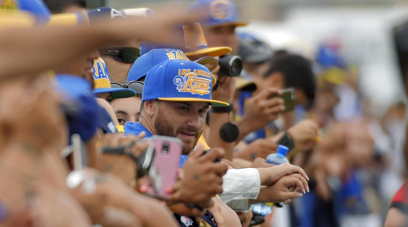Fans watch the St. Louis Rams and the Dallas Cowboys participate in a joint NFL football training camp, Monday, Aug. 17, 2015, in Oxnard, Calif. (AP Photo/Mark J. Terrill)