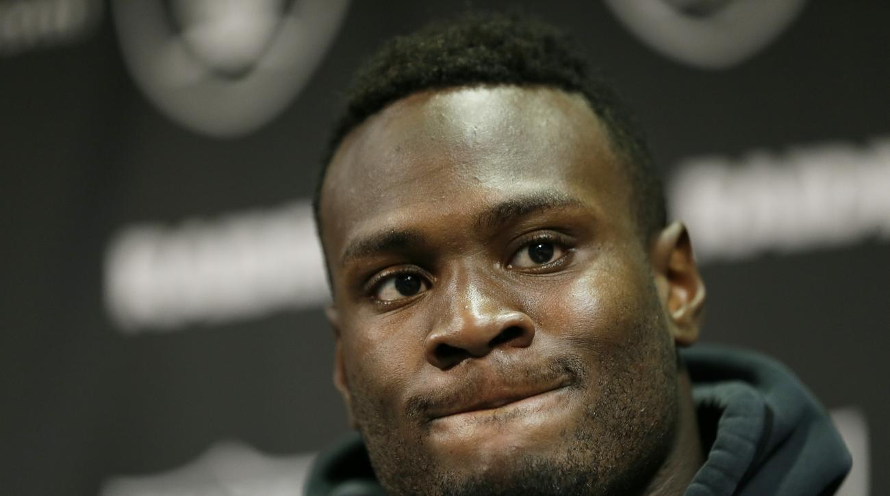 FILE - In this June 10, 2015, file photo, Oakland Raiders running back Latavius Murray listens during a news conference after mini camp at an NFL football facility in Alameda, Calif. After being more of a spectator than participant his first two years in