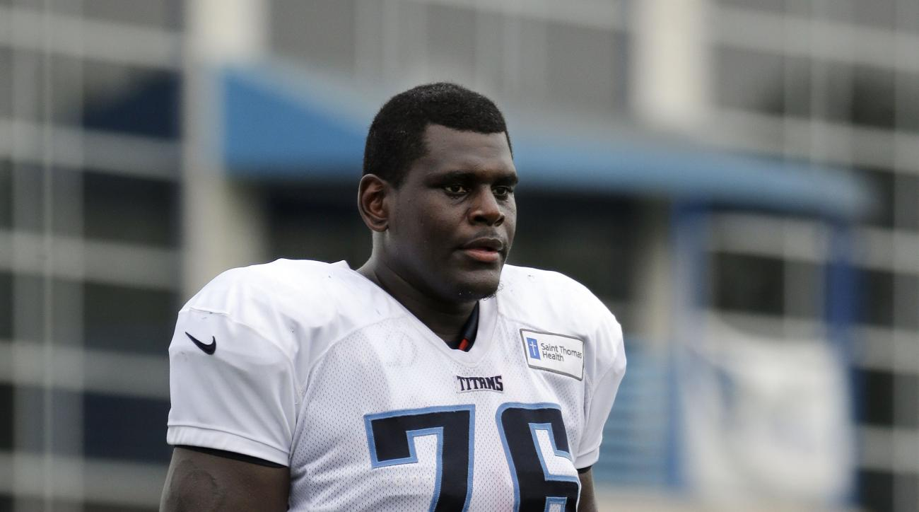 In this Aug. 5, 2015 photo, Tennessee Titans tackle Byron Bell takes a break during NFL football training camp in Nashville, Tenn. The Titans find themselves shuffling the offensive line around and Bell is getting work at left guard. (AP Photo/Mark Humphr