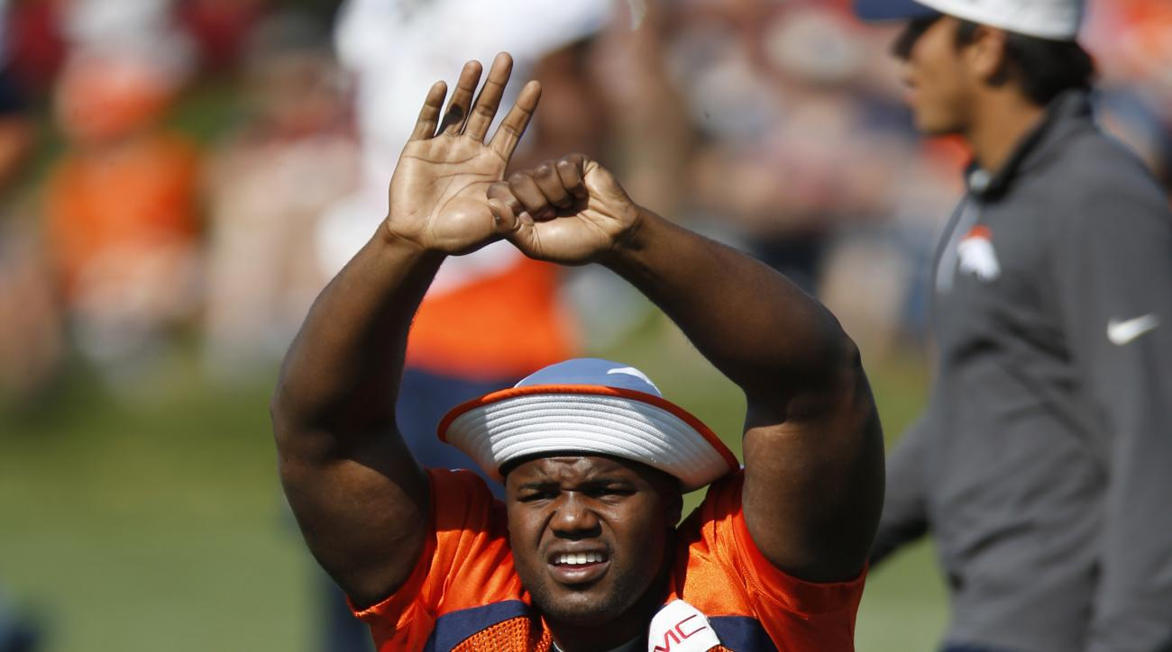 Denver Broncos defensive tackle Marvin Austin stretches during the morning session at the team's NFL football training camp Tuesday, Aug. 18, 2015, in Englewood, Colo. (AP Photo/David Zalubowski)