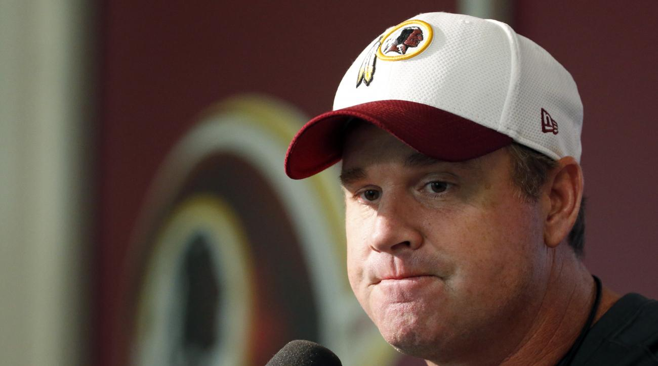 Washington Redskins coach Jay Gruden pauses while speaking to reporters after NFL football practice, Tuesday, Aug. 18, 2015 in Ashburn, Va. (AP Photo/Alex Brandon)