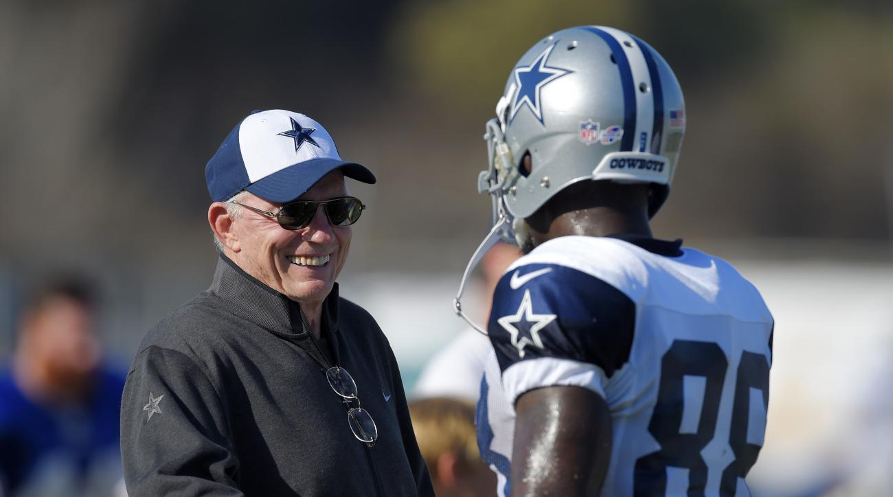 Dallas Cowboys owner Jerry Jones, left, talks with wide receiver Dez Bryant during a joint NFL football training camp with the St. Louis Rams, Tuesday, Aug. 18, 2015, in Oxnard, Calif. (AP Photo/Mark J. Terrill)