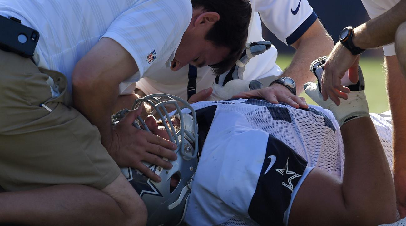 Dallas Cowboys guard Zack Martin is tended to after being injured during a joint NFL football training camp with the St. Louis Rams, Tuesday, Aug. 18, 2015, in Oxnard, Calif. (AP Photo/Mark J. Terrill)