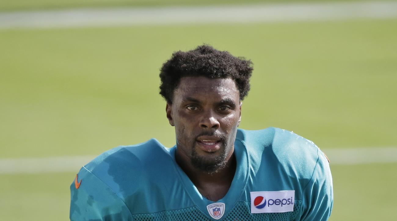 Miami Dolphins free safety Louis Delmas is shown during an NFL football training camp practice, Tuesday, Aug. 11, 2015 in Davie, Fla. (AP Photo/Wilfredo Lee)