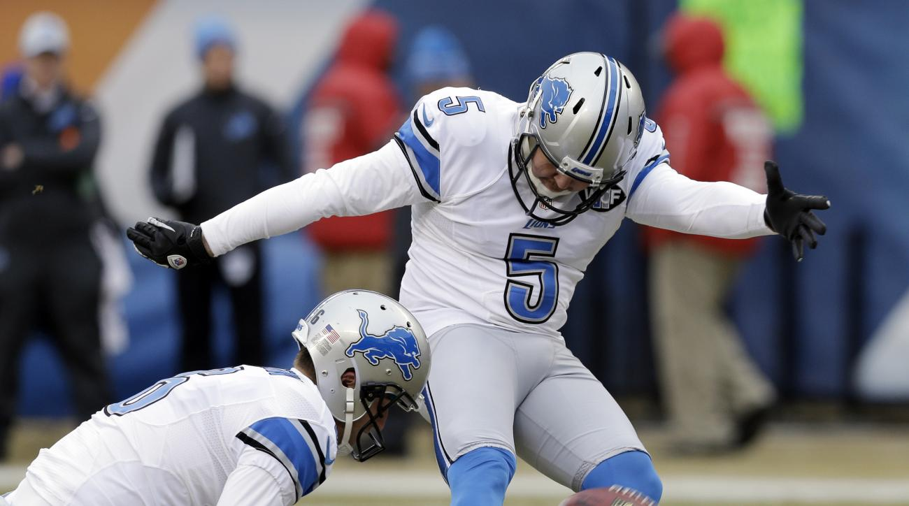 FILE - In this Dec. 21, 2014, file photo, Detroit Lions kicker Matt Prater (5) kicks an extra point in the first half of an NFL football game against the Chicago Bears in Chicago. Detroit's kicking game was a mess last year until Prater joined the Lions a