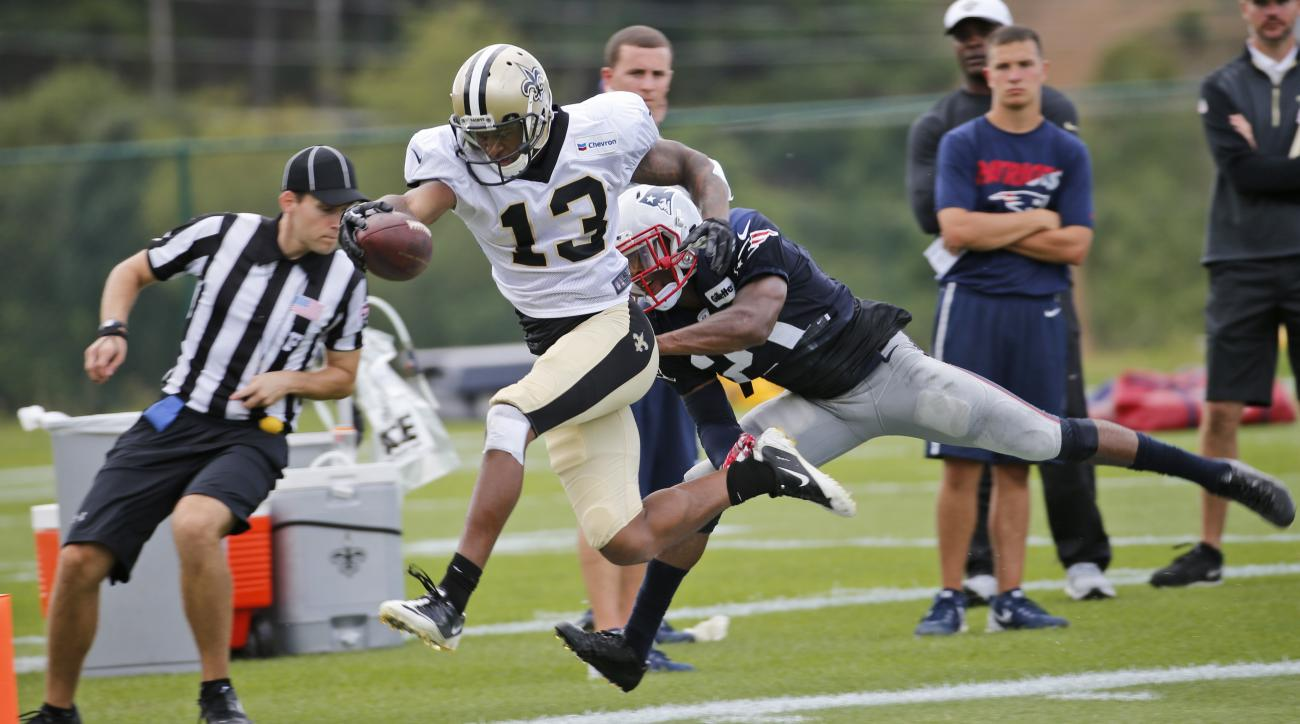 New Orleans Saints wide receiver Joseph Morgan (13) stretches to the end zone as New England Patriots cornerback Malcolm Butler (21) tries to make the stop during a joint practice at the Saints' NFL football training camp in White Sulphur Springs, W.Va.,