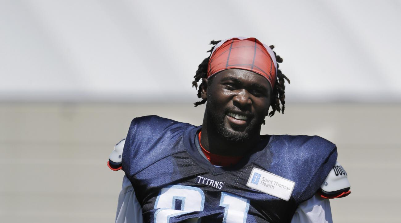 Tennessee Titans safety Da'Norris Searcy takes a break during NFL football training camp Sunday, Aug. 2, 2015, in Nashville, Tenn. (AP Photo/Mark Humphrey)