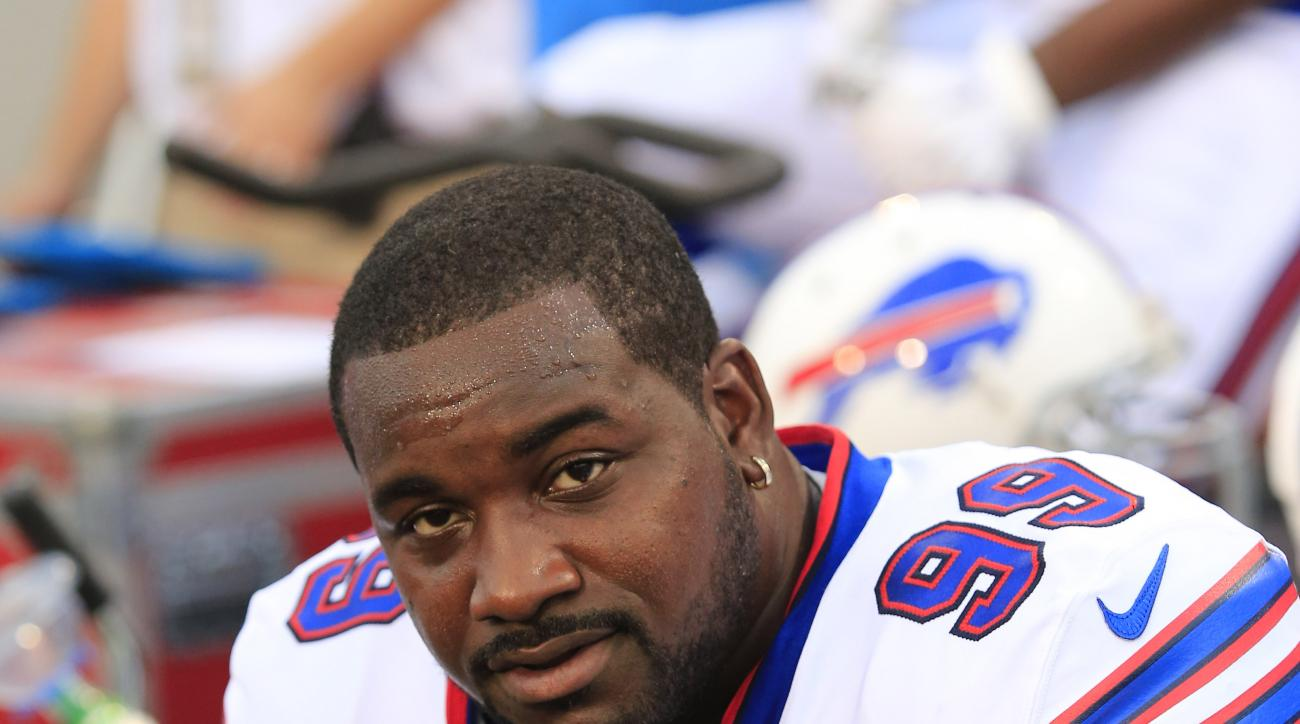 Buffalo Bills defensive tackle Marcell Dareus (99) watches the action during the first half of an NFL preseason football game against the Carolina Panthers  on Friday, Aug. 14, 2015, in Orchard Park, N.Y. (AP Photo/Bill Wippert)