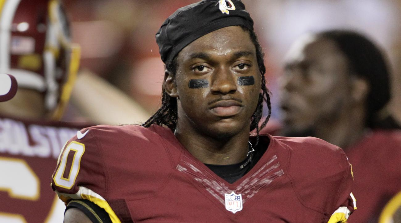 Washington Redskins quarterback Robert Griffin III walks off the field after an injury during the first half of an NFL preseason football game against the Detroit Lions, Thursday, Aug. 20, 2015, in Landover, Md. (AP Photo/Mark Tenally)