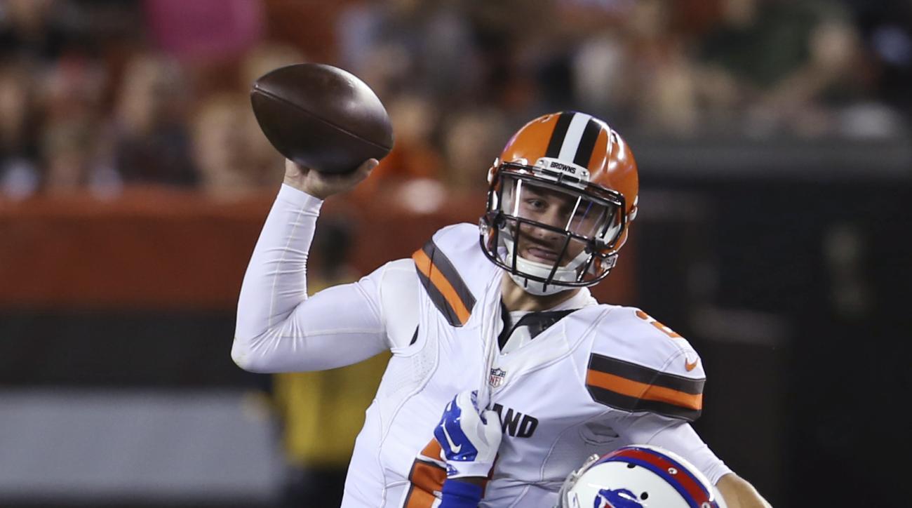 Buffalo Bills cornerback Merrill Noel (46) sacks Cleveland Browns quarterback Johnny Manziel during the third quarter of an NFL preseason football game, Thursday, Aug. 20, 2015, in Cleveland. (AP Photo/Ron Schwane)
