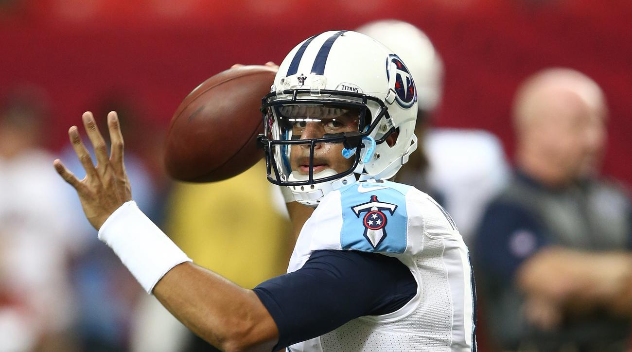 FILE - In this Aug. 14, 2015, file photo, Tennessee Titans quarterback Marcus Mariota warms up before an NFL football preseason game against the Atlanta Falcons in Atlanta. Tennessee rookie quarterback Marcus Mariota finally is ready for his home debut th
